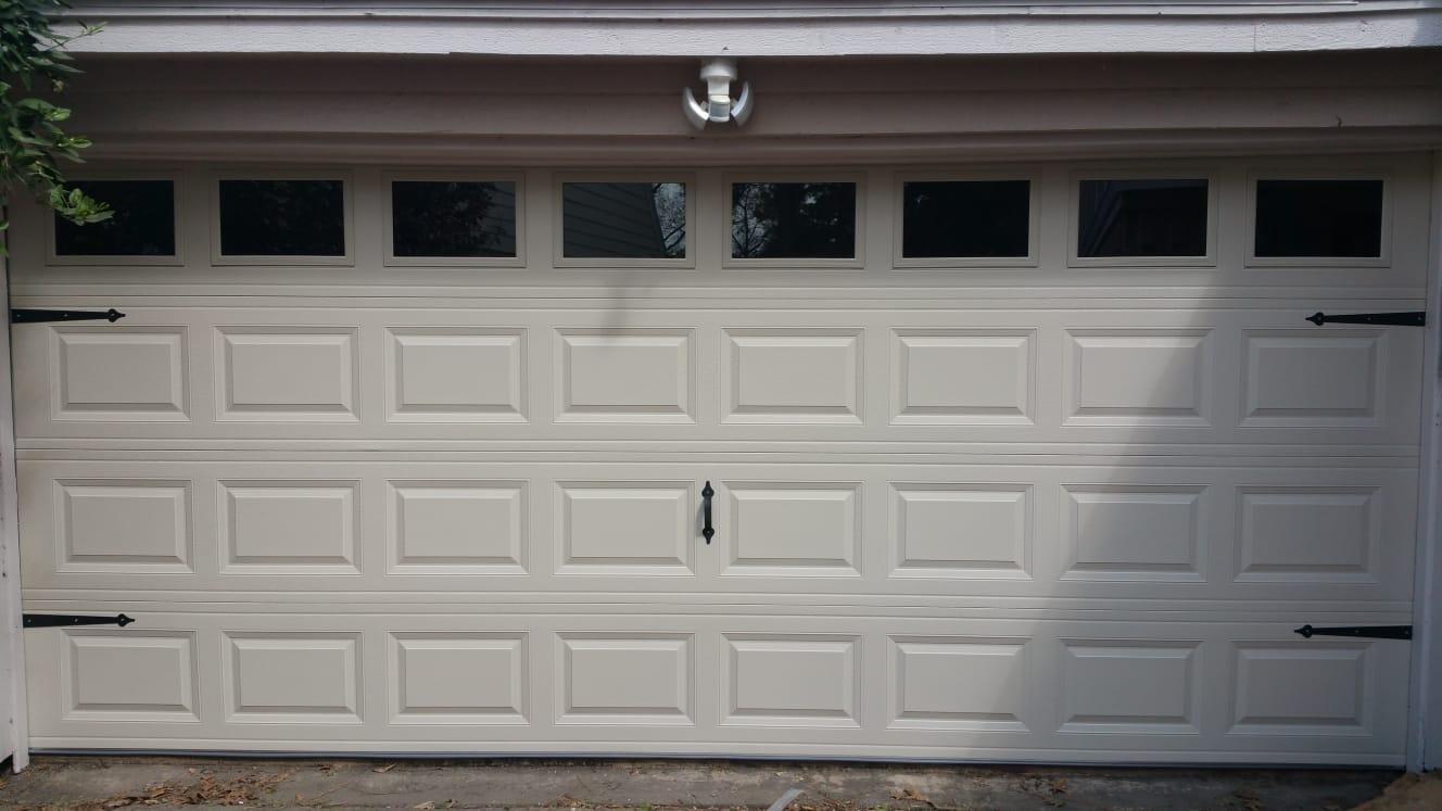 Repairman replacing garage door for garage door service